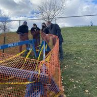 Parks Department Commissioner Woods and Archaeology Program Team look into Ronan Park well